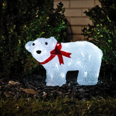 LED baby polar bear, standing with a red ribbon